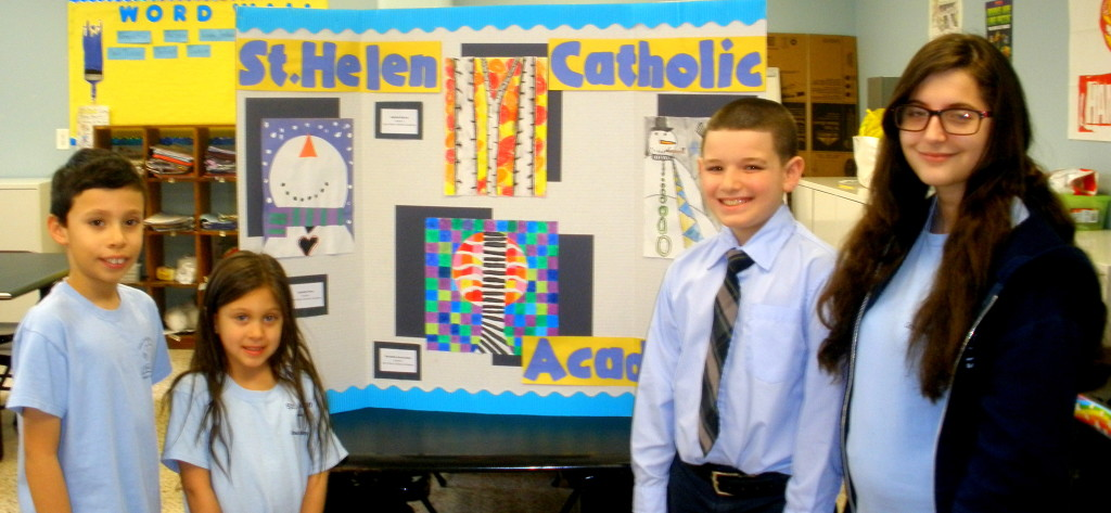 Students at St. Helen Catholic Academy display art.