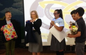 Academy principal and students present gifts to Assemblywoman Davila at St. Frances Cabrini Catholic Academy.