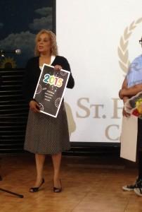 Students present gifts to Assemblywoman Davila at St. Frances Cabrini Catholic Academy.