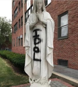 Vandalized statue of the Blessed Mother